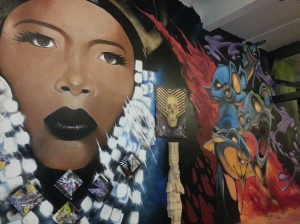 Urban tinges juxtaposed with a mural of Egyptian-like beauty. Part of Box Social's exhibit.